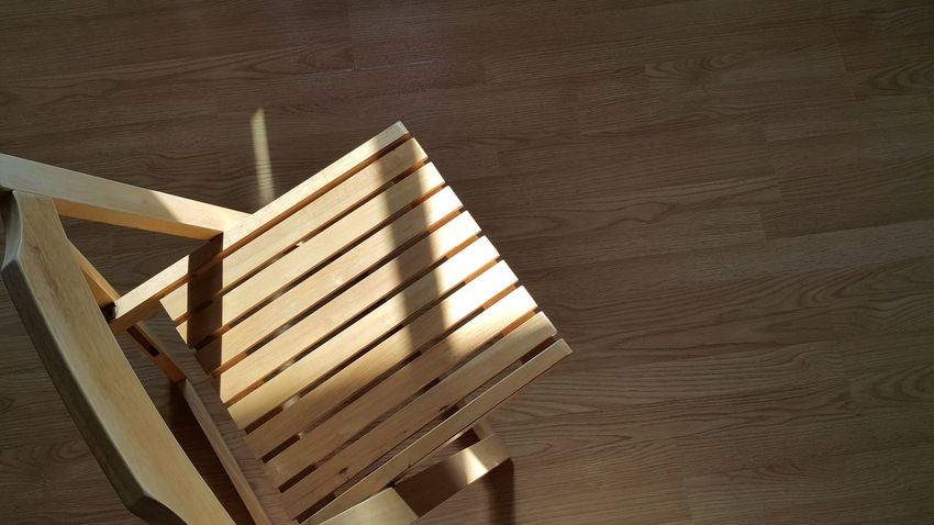 The Sun shining on the wooden chair. Chairs Close-up Day Furniture High Angle View Indoors  No People Shadow Sun Light Reflection Wood - Material Wooden Texture