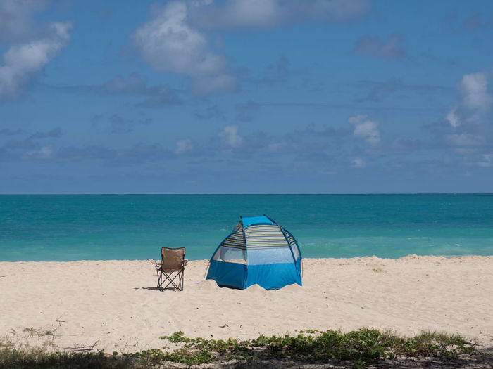 Oahu Hawaii Waimanalo Beach Beach Beauty In Nature Blue Chair On Beach Cloud - Sky Day Horizon Over Water Idyllic Nature No People Outdoors Sand Scenics Sea Shore Sky Tent Tranquil Scene Tranquility Vacations Water
