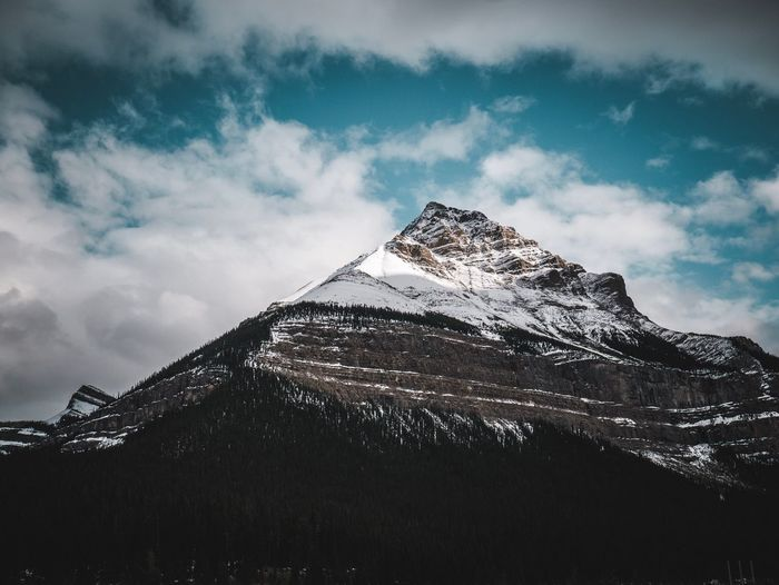 Moody Winterpeak in sunlight Wekeepmoments Canada National Park Cloud - Sky Sky Nature Low Angle View No People Beauty In Nature Scenics - Nature Snow Snowcapped Mountain Winter Travel Destinations Mountain Outdoors Day My Best Photo