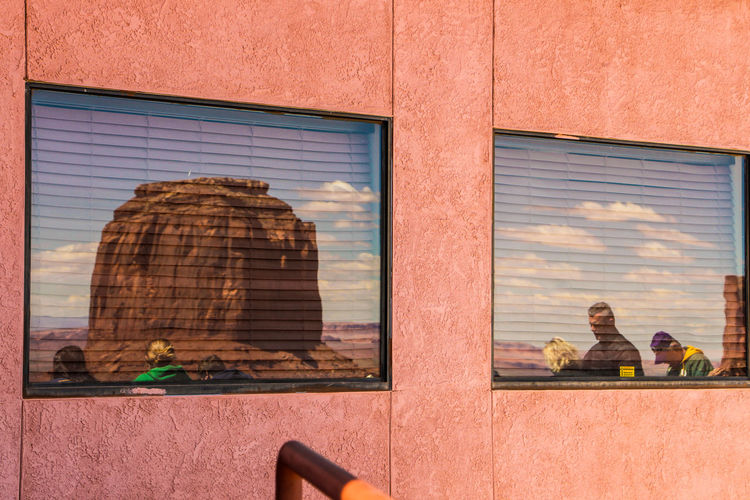 Architecture Building Exterior Built Structure Window Building Real People Day Men Glass - Material People Outdoors Group Of People Lifestyles Adult Reflection Women Rear View City Sitting Brick Glass Son Monument Valley,Utah USA Monument Valley Tribal Park