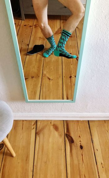 Sunday Socks Human Leg Human Body Part Low Section Body Part One Person Real People Lifestyles Women Leisure Activity Standing Limb Human Limb Human Foot Indoors  High Angle View Flooring Shoe Adult Personal Perspective Tiled Floor