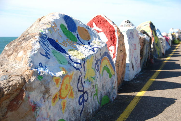 Day Graffiti Art Large Rocks Light And Shadow No People Outdoors Row Of Rocks Row Of Things Sky Spray Paint Travel Desinations Way Forward