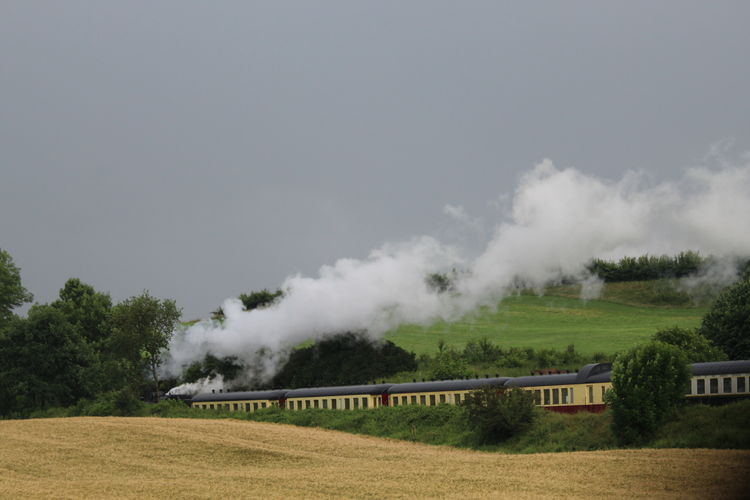Driving Away Field Landscape No People Outdoors Photography In Motion Sky Steam Steam Locomotive On The Way