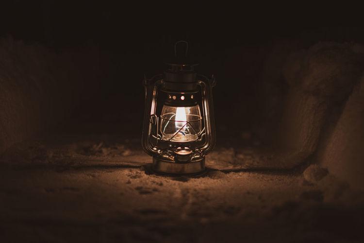 Close-up of illuminated light bulb in the dark