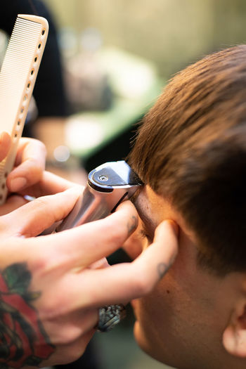 High angle view of man sitting in hair salon