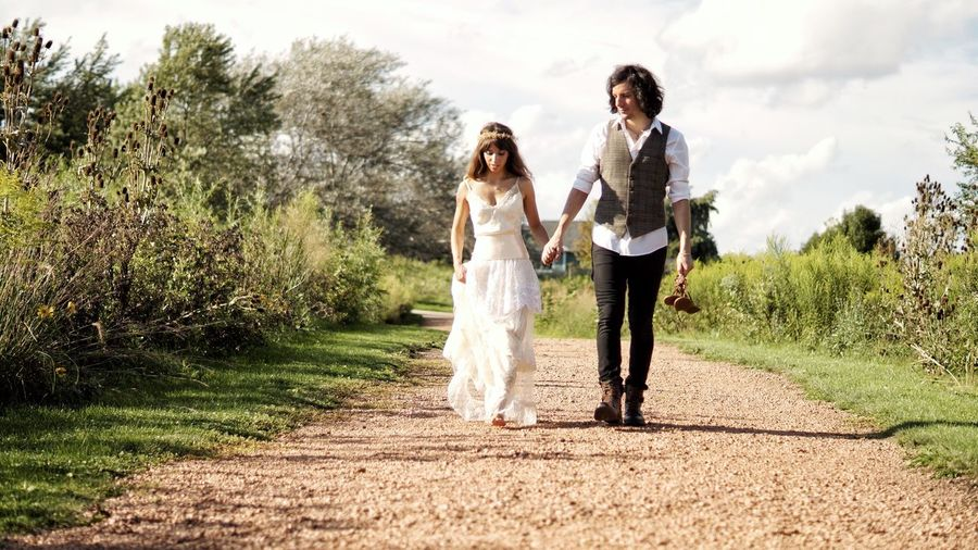 Young couple walking on footpath