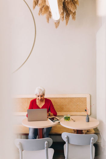 Woman sitting on chair at table