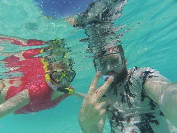 Close-Up Of People Taking Selfie Underwater