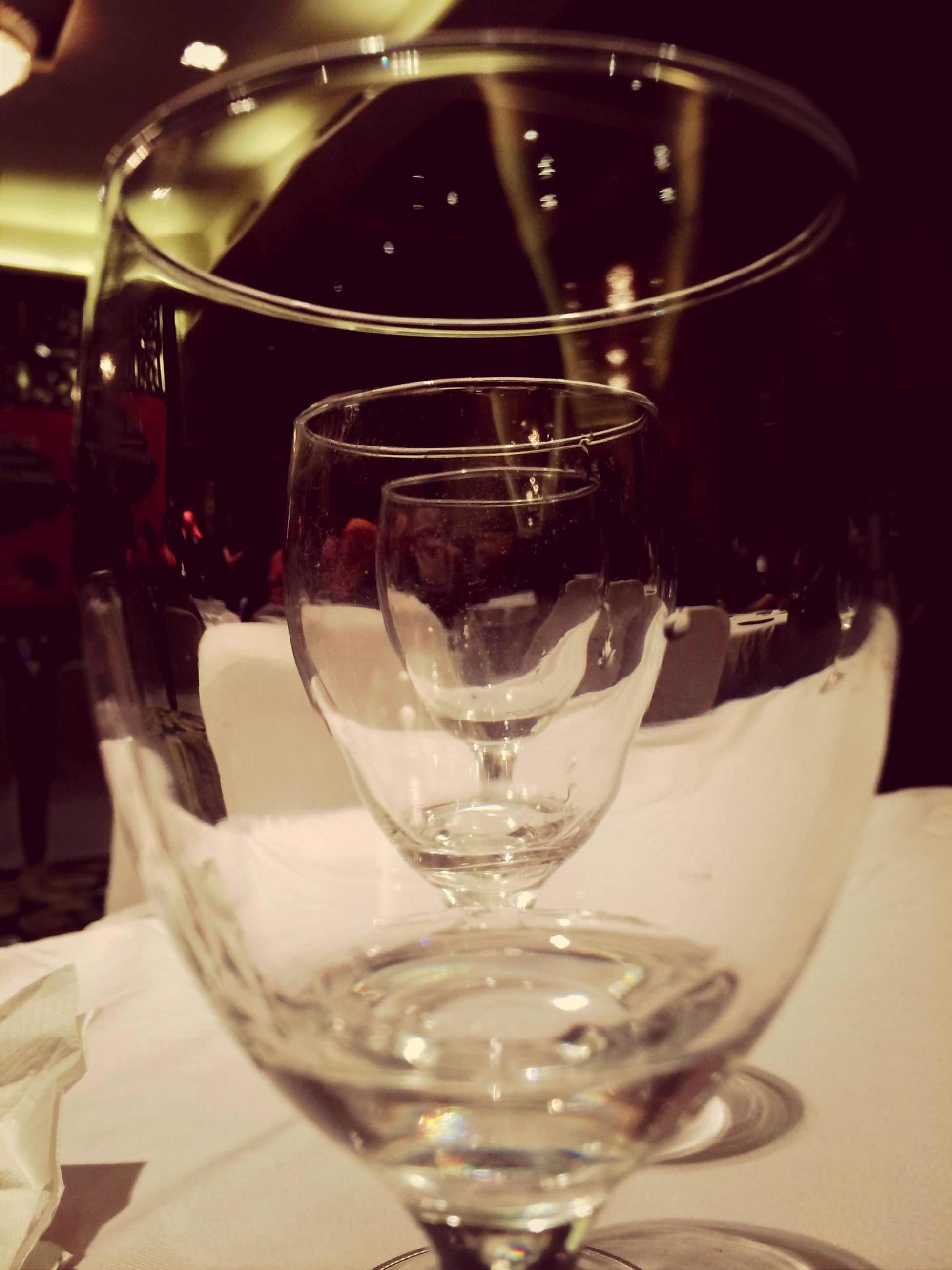 drink, drinking glass, refreshment, food and drink, indoors, table, glass - material, wineglass, alcohol, freshness, transparent, close-up, wine, still life, glass, focus on foreground, restaurant, alcoholic drink, cocktail, red wine