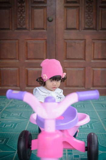 Baby Girl On Tricycle