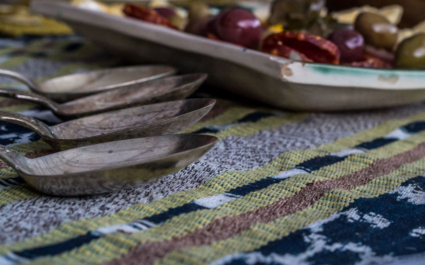 Close-up Indoors  No People Entertaining Spoons Table Silver  Silverware  Rustic Olives Plate Warm Welcome Entertaining At Home Appetizers Texture Colourful Linen Table Runner Chorizos