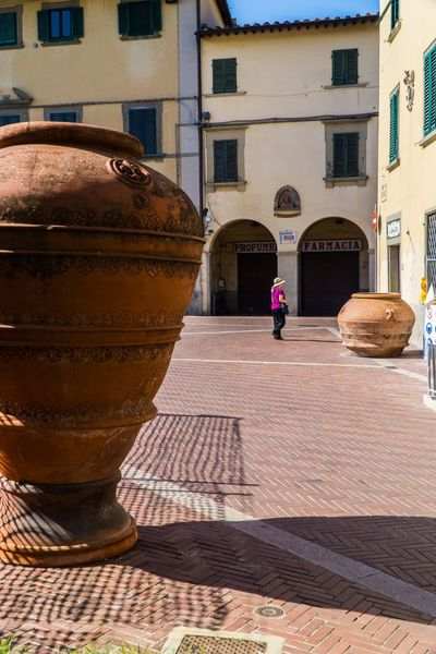 Montelupo, italy Woman Montelupo Fiorentino Clay Terra Cotta Pots Architecture Built Structure Building Exterior Building City Sunlight Street Shadow Full Length Walking Incidental People Lifestyles Real People One Person Outdoors Day Women Nature Men
