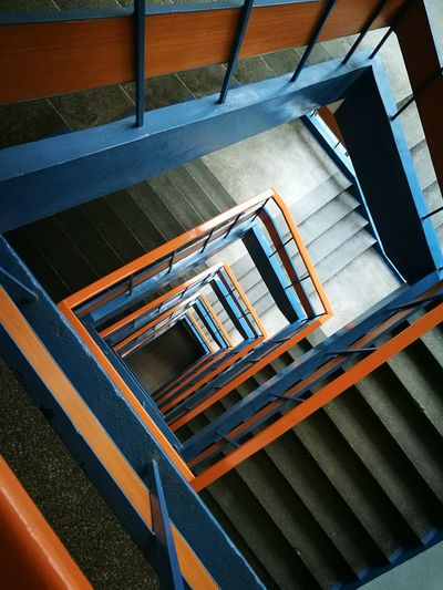 Steps And Staircases High Angle View Staircase Railing Steps Built Structure No People Architecture Day Corridor Light Effect Illuminated The Way Forward Exit Sign Indoors  Architecture Steps Spiral Fire Escape Spiral Staircase Railing The Architect - 2017 EyeEm Awards