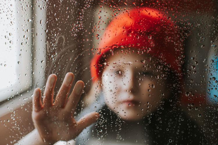 Close-up portrait of wet glass window in rainy season