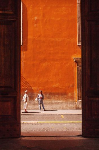 Rome Street Photography Orange Scale  Urban Landscape Urban Photography Urban Life Waiting For The Bus Italy Streetphotography Streetphoto_color Street Life Shooting Through Doors Street EyeEm Best Shots - The Streets Urban Exploration TakeoverContrast Break The Mold