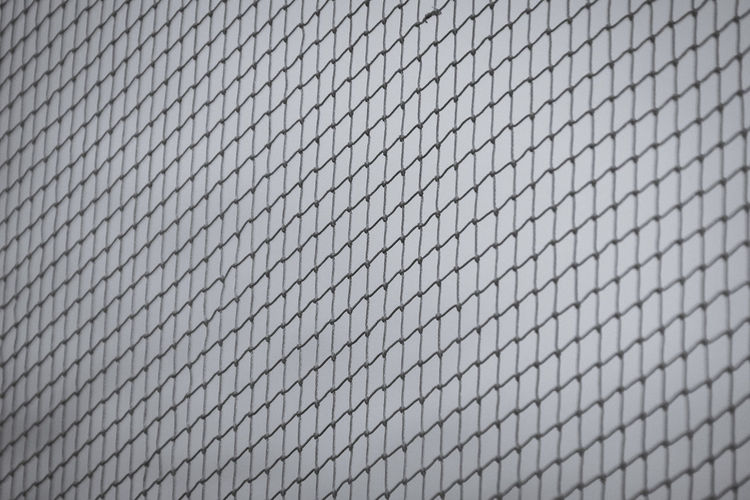 Backgrounds Built Structure Close-up Day Fence Full Frame Looking Through Mesh Netting No People Outdoors Pattern Protection Repetition Security Textured