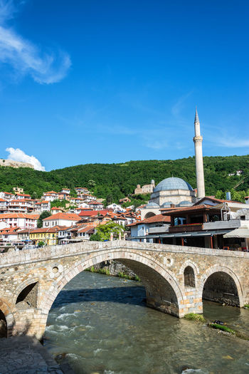 Old Stone Bridge and cityscape view in the historic center of Prizren, Kosovo Prizren Kosovo Architecture Travel Travel Destinations Tourism Eastern Europe Balkan Balkans Historic Medieval Cityscape Urban Mosque Sinan Pasha Sinan Pasha Mosque Minaret Tower Stone Bridge Old Stone Bridge Ottoman River Riverside Built Structure Building Exterior