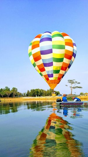Balloon Thailand Hot Air Balloon Ballooning Festival Water Flying Multi Colored Adventure Sport Mid-air Reflection Sky Scenics Kiteboarding Parasailing Parachute Float Tranquil Scene Helium Balloon Gliding Extreme Sports Stunt Person Balloon Horizon Over Water Windsurfing Countryside Skydiving Tranquility Calm Helium Non-urban Scene Aircraft Wing