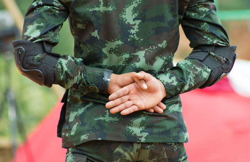 Unidentified A Soldier at Shan State in Myanmar Armed Forces Army Army Soldier Camouflage Clothing Clothing Day Focus On Foreground Government Green Color Gun Holding Human Body Part Midsection Military Military Uniform One Person Outdoors Real People Standing Uniform