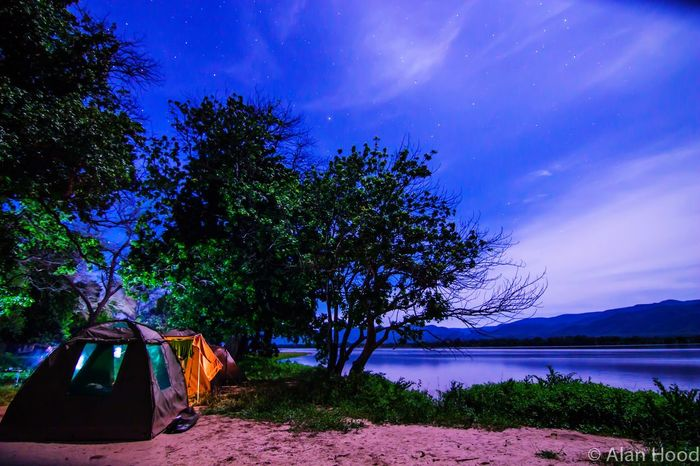 Camping on the banks of the Zambezi River Zimbabwe Africa Nightphotography Night Manapools Nature Starry Sky Stars Theroadlesstraveled Campsite Long Exposure