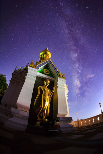 Low angle view of statue against sky at night