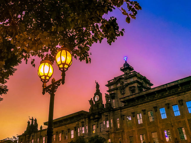 Imbued with Uneding Grace... Night Tree Illuminated Low Angle View Architecture Façade Outdoors Multi Colored No People Sky Clear Sky City Clock Face School UST GoUSTe National Heritage Historical Landmark University Sunset Cross Tria Haec Lamp Post Oldest University In Asia EyeEm Best Shots Eyeem Philippines