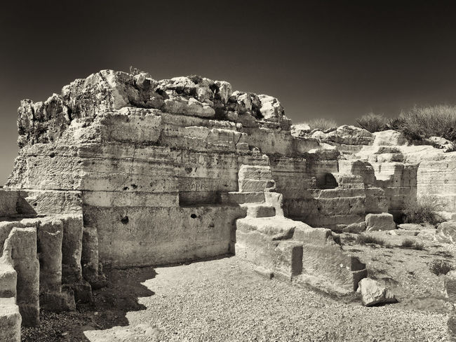 geometric carved rocks desert ruin scene Monochrome Alien Surreal Landscape Desert Ruins Ancient Old Ruin Sky Archaeology No People Damaged Ancient Civilization The Past Built Structure Mysterious Old