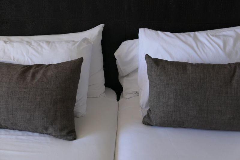 Close-Up Of Pillows On Bed At Home