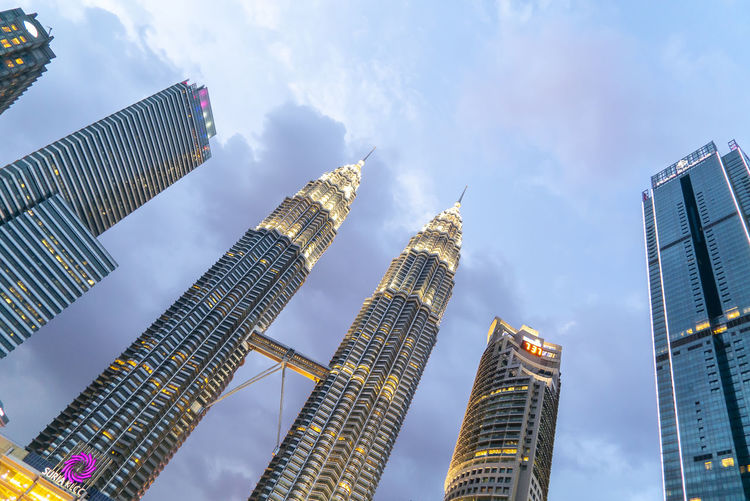 Sunset at Petronas Twin Towers KLCC, Kuala Lumpur Building Exterior Built Structure Architecture Office Building Exterior City Tall - High Sky Cloud - Sky Building Skyscraper Low Angle View Office Modern Tower Nature No People Travel Destinations Day Outdoors Financial District  Cityscape Spire