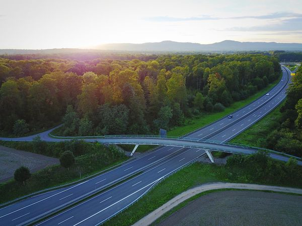 Road to the hills DJI X Eyeem Road Winding Road Transportation Aerial View Landscape Sky Nature No People Mountain Outdoors Forest DJI Mavic Pro Dji Sunset Green Color (null) Lost In The Landscape High Angle View The Great Outdoors - 2017 EyeEm Awards Asphalt Day Scenics An Eye For Travel