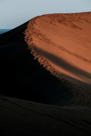 Sand Land Sky Sand Dune Desert Scenics - Nature Tranquil Scene No People Arid Climate Nature Tranquility Landscape Beauty In Nature Climate Environment Non-urban Scene Clear Sky Remote Sunset Brown Outdoors