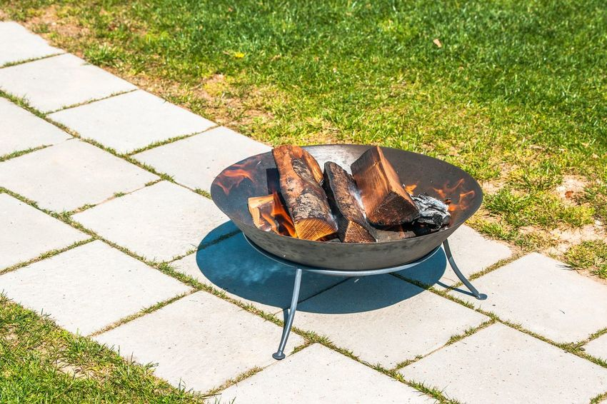 Garden bonfire on the terrace in the summer Grill Fire Bonfire High Angle View Grass Sunlight Day Nature Plant No People Park - Man Made Space Food And Drink Field Park Shadow Outdoors Growth Food Geometric Shape Footpath Green Color Land Shoe