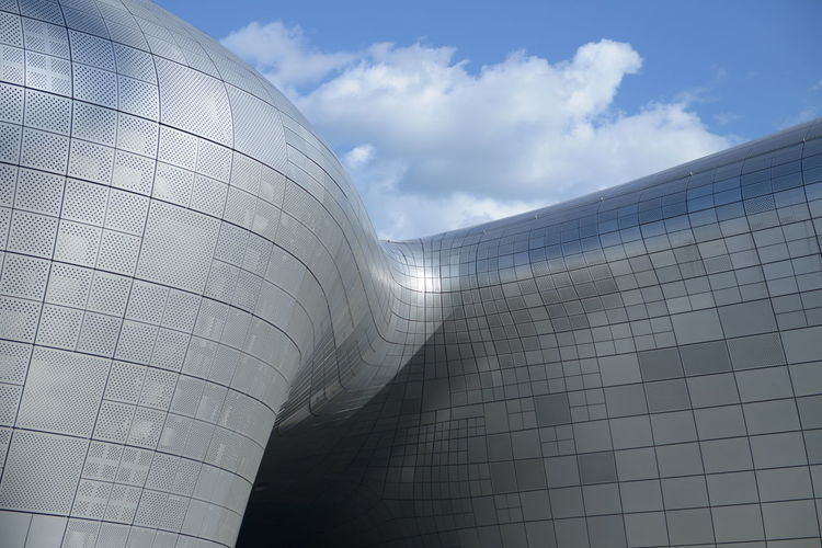 Sky Cloud - Sky Built Structure Architecture Day Nature Low Angle View Building Exterior No People Modern Outdoors Sunlight City Office Building Exterior Pattern Metal Wall - Building Feature Shiny Reflection Shape Silver Colored