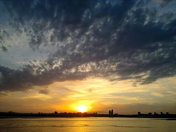 Sunset Sky Cloud - Sky Scenics Dramatic Sky Beauty In Nature Sun Silhouette Nature Orange Color Tranquility Tranquil Scene Outdoors Water No People Landscape Sea Building Exterior Day Volga Sommergefühle