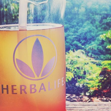 Drinking my Aloe Juice + Tea Mix on top of the first hill :) Sweating in bullets! Herbalife