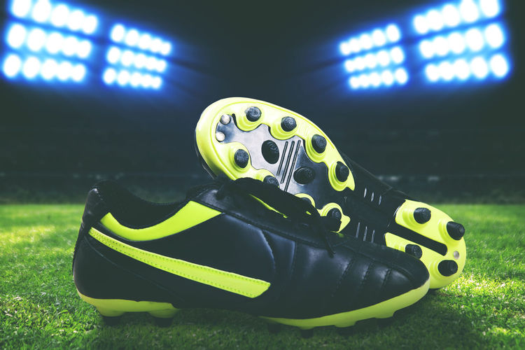 Soccer boots on a field Light Soccer Boots Baseball - Sport Boot Close-up Game Illuminated Night No People Outdoors Shoes Soccer Soccer Field Sport Stadium