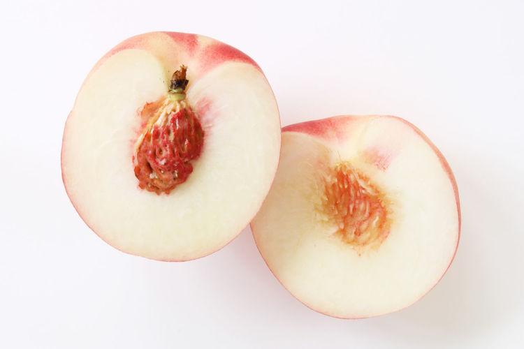 Directly above shot of fruit on white background