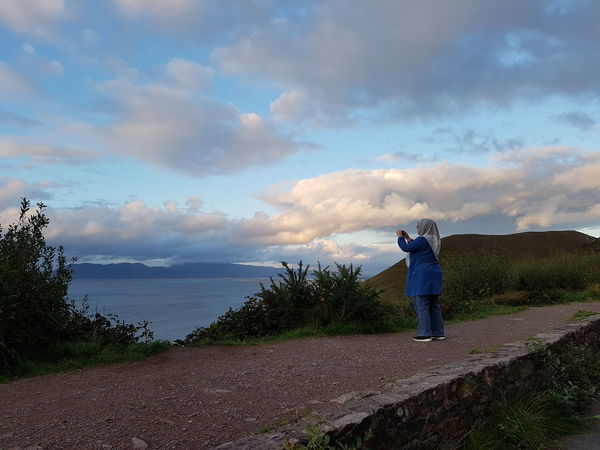 Capturing beautiful evening view at Ring of Kerry, Ireland. Travel Water Full Length Photography Themes Standing Photographing Sea Tree Rear View Sky Calm Horizon Over Water Tranquil Scene Scenics Coast Cloud Ocean