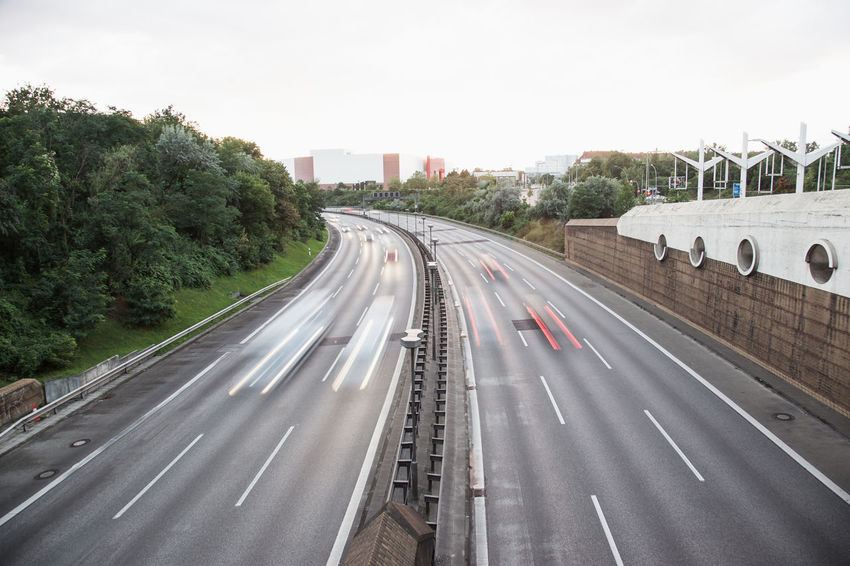 German Autobahn in Berlin with late rush hour traffic, cars speeding with motion blur Afternoon Driving German Rush Hour Speeding Traffic Architecture Autobahn Built Structure City Day Evening Highway Land Vehicle Motion Motorway No People Outdoors Road Sky Speed Transportation Tree