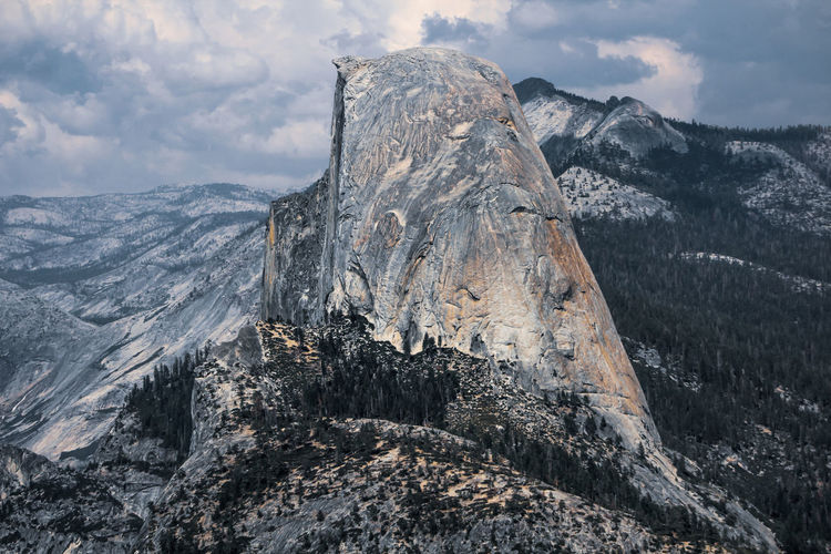 Scenic view of yosemite half dome snowcapped mountains against sky