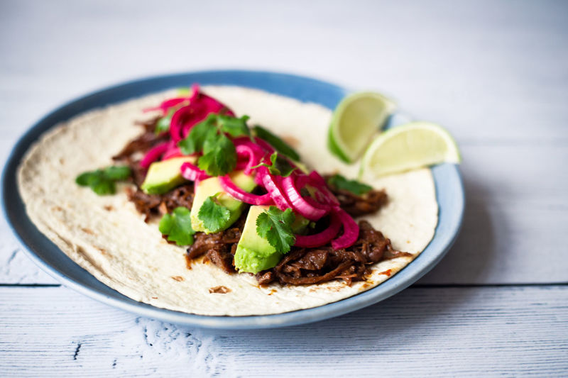 Beef cheek tacos Food And Drink Food Healthy Eating Freshness Wellbeing Ready-to-eat Vegetable Indoors  Close-up No People Meat Garnish Beef Tacos Avocado Cilantro Coriander Lime Tortilla Mexican Food Texmex White Background Onions Pink Color
