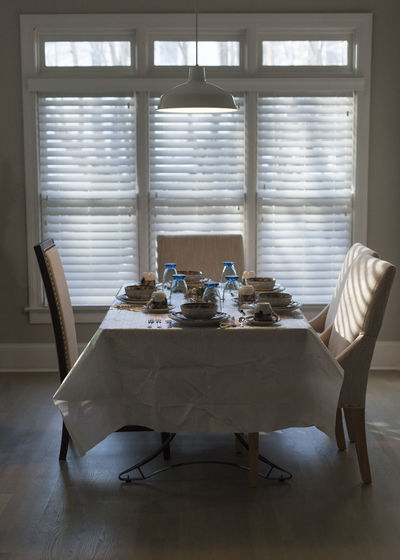 Dining table by window at home