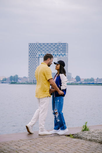 Young couple standing in water