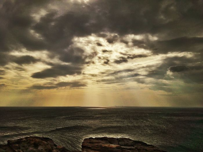 Sea Beach Sunset Cloud - Sky Horizon Over Water Nature Water Scenics Dramatic Sky Beauty In Nature Outdoors No People Tranquility Tranquil Scene Sky Sunlight Travel Destinations Wave Day
