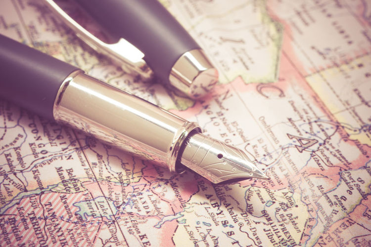 Close-up of fountain pen on map