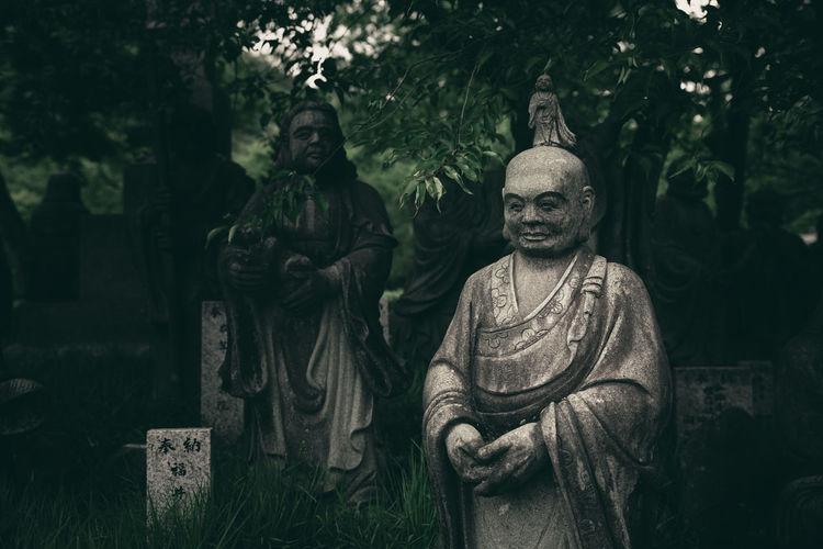 Buddha statue in cemetery