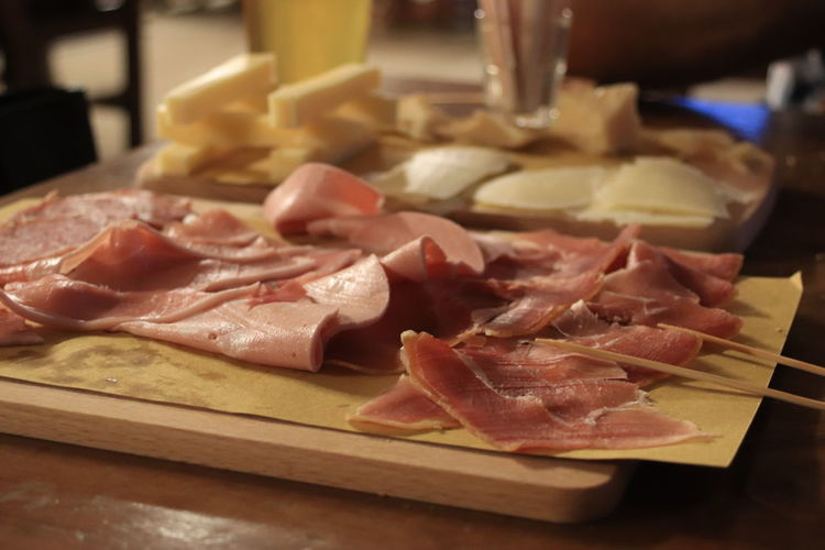 Italian prosciutto and cheese, cold cuts Prosciutto Sashimi  Butcher Pork Quality Meat Italian Food SLICE Bacon Cutting Board Processed Meat Red Meat The Still Life Photographer - 2018 EyeEm Awards The Traveler - 2018 EyeEm Awards EyeEmNewHere