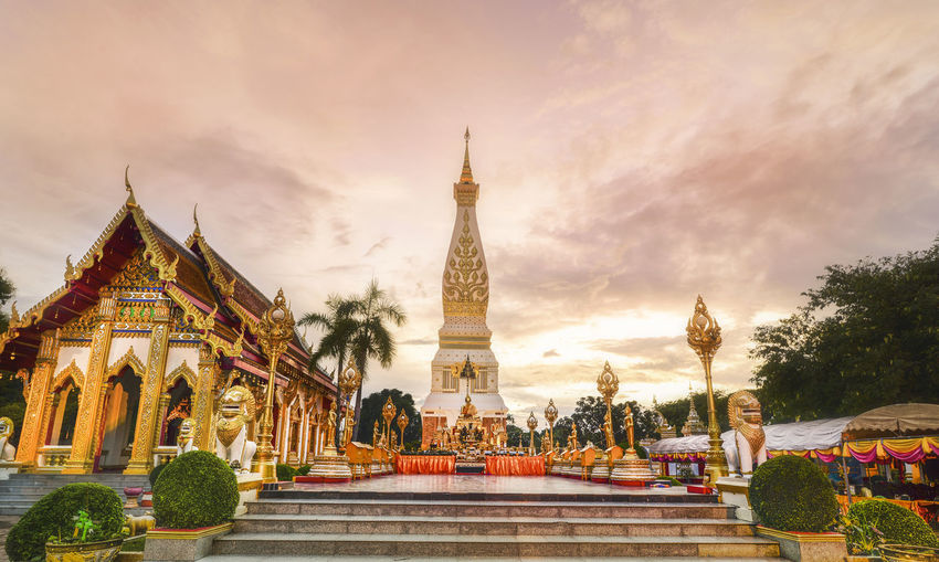 Buddhist Temple and Temple That Phanom Architecture Built Structure Cloud - Sky Building Exterior Sky Art And Craft Building Sculpture Religion Belief Statue Human Representation Place Of Worship Travel Destinations Nature Representation History The Past Spirituality Plant Outdoors Spire  Ornate Temple