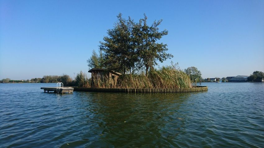 Island in the lake Tree Water Clear Sky Lake Nautical Vessel Nature Outdoors Tranquility Day No People Blue Sky Beauty In Nature Lake Island Zuidholland Groene Hart Langeraar Travel Destinations Lost In The Landscape Nieuwkoop Nederland