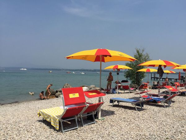 Dogbeach PeschieraDelGarda Del Garda Italian Lake Beach Sea Sand Water Horizon Over Water Shore Nature Tranquility Outdoors Beauty In Nature Tranquil Scene Vacations Day Sky No People